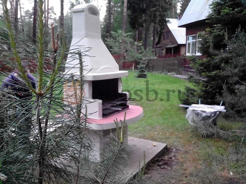 фотография готовой бетонной дачной барбекю печи